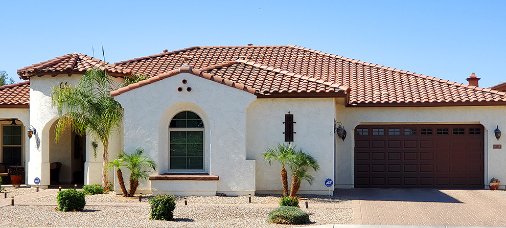 Modest sized residential home in Arizona, with a tiled roof.